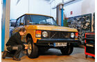 Range Rover Classic, Werkstatt, Frontansicht, Radschraube anziehen